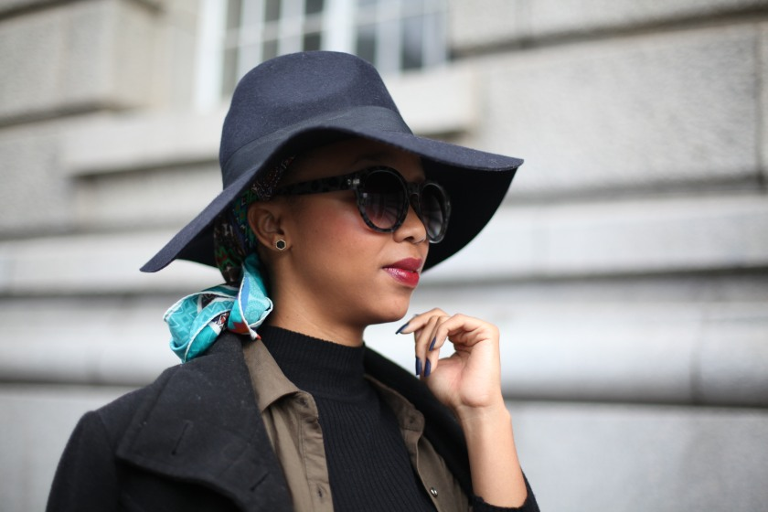 04_poloneck_camo_shirt_highwaist_jeans_chunky_cut_out_ankle_heels_coat_floppy_felt_hat_head_scarf_through_shaded_eyes_by_tokelo_motsepe